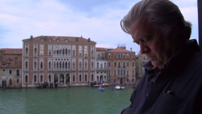 A gray-haired man looks down on the background of the Venice Canal