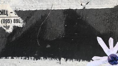 Abstract painting depicting a black rectangle on a gray background